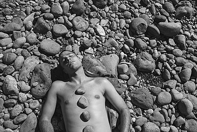 Bare Chested Man and Hot Rocks - p1262m1108899 by Maryanne Gobble
