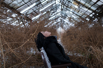Girl in an old greenhouse - p1646m2227379 by Slava Chistyakov