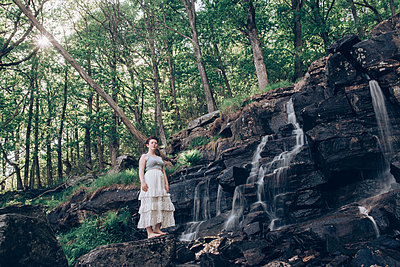 By the waterfall - p1507m2092592 by Emma Grann