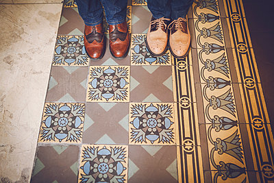 Persons in men's shoes - p1150m1194436 by Elise Ortiou Campion
