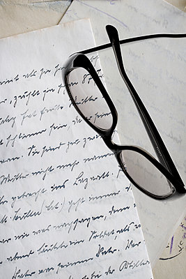 Glasses on an old letter - p450m1223301 by Hanka Steidle