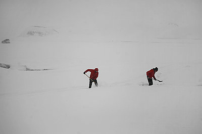 Men shoveling snow on path after snow storm, Iceland - p1028m1185106 by Jean Marmeisse