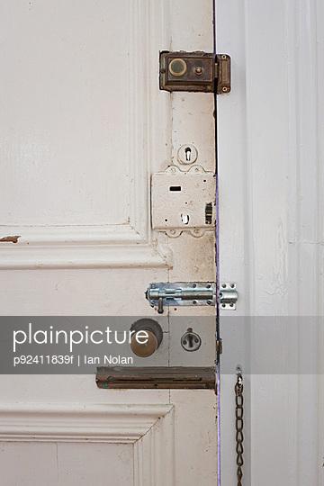 Door with many locks and bolts - p92411839f by Ian Nolan