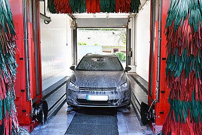 Car in a car wash - p300m1047457f by lyzs