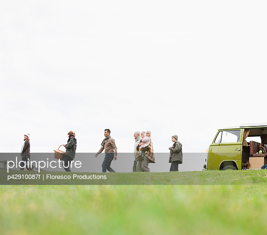 Family heading out for picnic - p42910087f by Floresco Productions