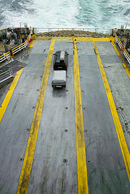 Car with trailer on ferry - p3882171 by Andre