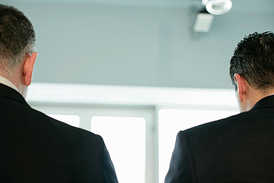 Rear view of two businessmen - p4733560f by Stock4B