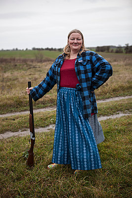 Farmer's wife with a gun - p502m892138 by Tomas Adel