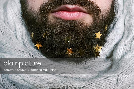Golden stars in man's beard - p300m2155969 by Ekaterina Yakunina