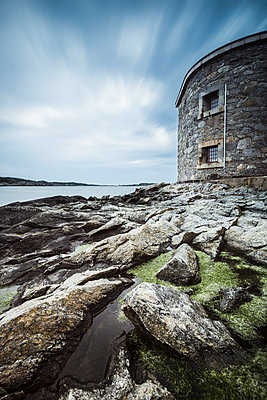 Stone building on rocky coast - p312m1522216 by Mikael Svensson