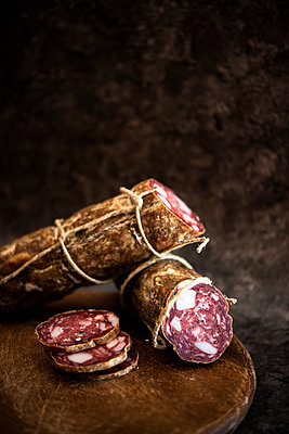 Whole salami, cut and sliced - p429m2164651 by Senserini Lucrezia