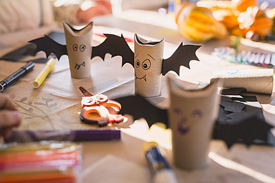 Tinkered paper bats on desk - p300m1113642f by Anke Scheibe