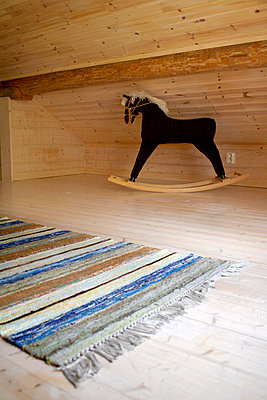 Rocking-Horse With No Tail On The Loft - p8473594 by Johanna Norin