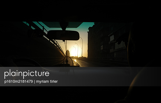 View in sunny road from the inside of a car - p1610m2181479 by myriam tirler
