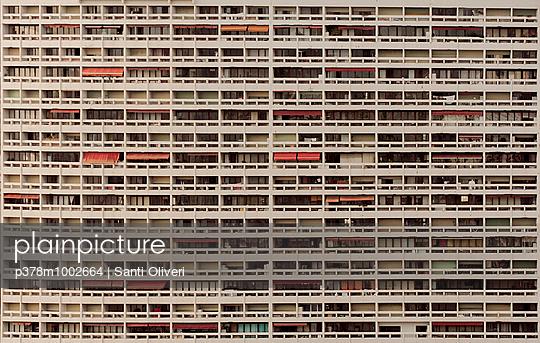 Massive building facade - p378m1002664 by Santi Oliveri