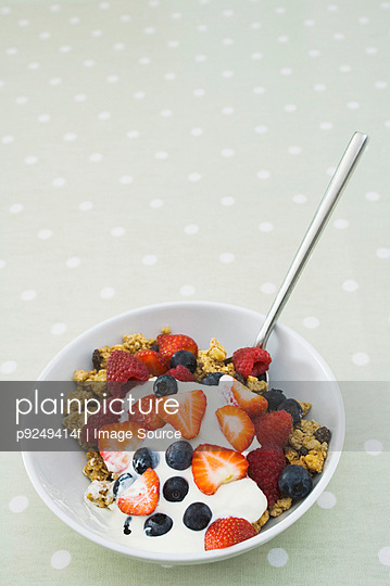 Fruit and granola breakfast - p9249414f by Image Source
