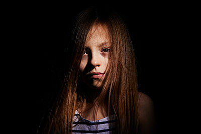 portrait on a black background of a long haired girl - p1540m2192303 by Marie Tercafs