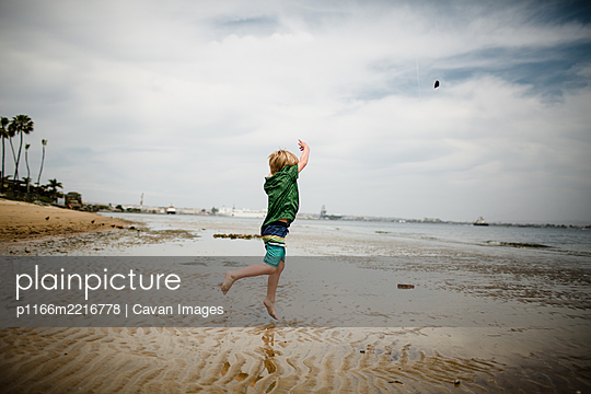 Six Year Old Boy Skipping Rocks in Coronado Bay - p1166m2216778 by Cavan Images