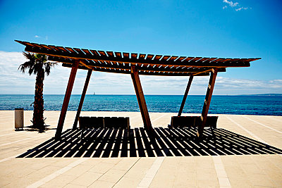 Benches Under Slatted Roof on Promenade, Mallorca, Spain - p6943687 by Måns Berg