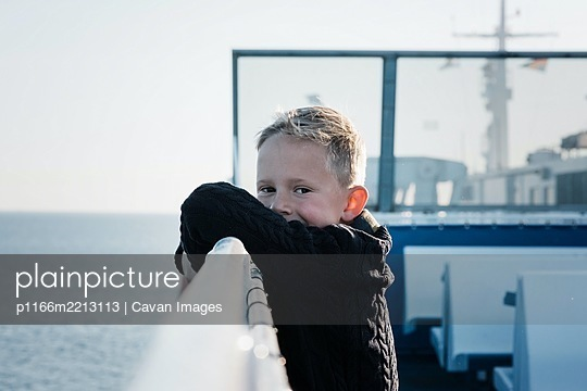 portrait of a young boy on a ferry looking happy and relaxed at sea - p1166m2213113 by Cavan Images