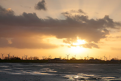 Germany, Bensersiel, coastal landscape with wind turbines at sunset - p300m1019163f by Wilfried Wirth