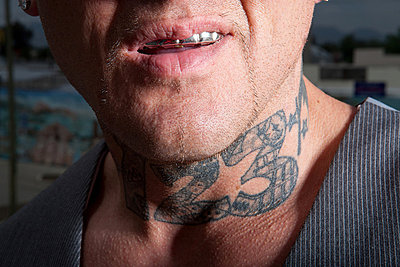Man with tattooed neck - p92411314 by Sean Murphy
