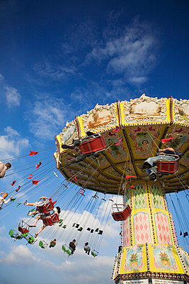 People riding on carousel at Oktoberfest beer festival in Munich - p6090350f by ENGLISH photography