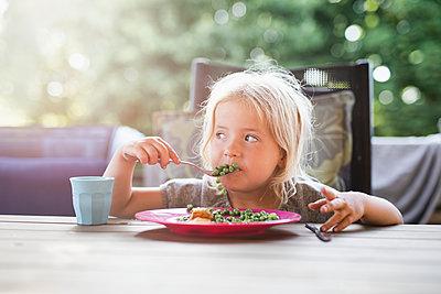 Girl having meal outside - p312m2091540 by Anna Johnsson