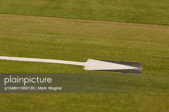 Grass runway arrow - p1048m1069139 by Mark Wagner