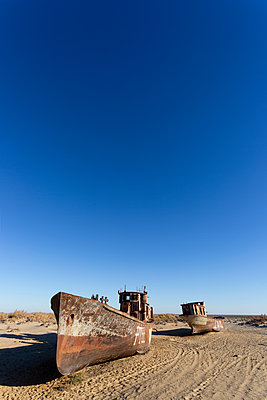 Ship wreckage in Moynaq, on the Aral sea, Uzbekistan - p590m2057417 by Philippe Dureuil