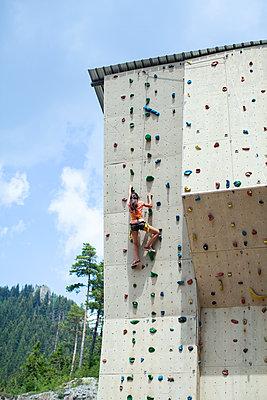 Girl climbing on a climbing wall - p1432m2273303 by Svetlana Bekyarova