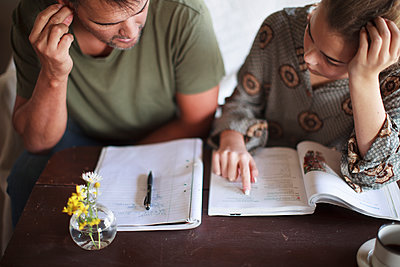 Father helping daughter with homework - p312m1533201 by Christina Strehlow