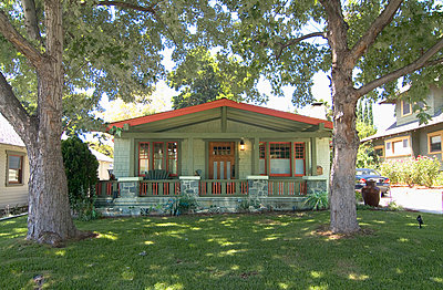 Exterior one story bungalow with red trim - p555m738607f by Douglas Keister