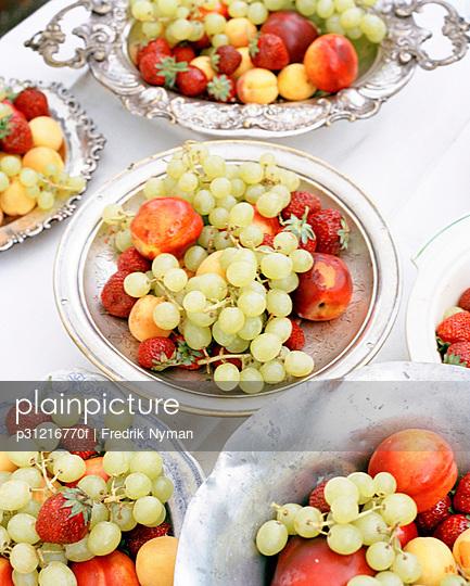 Fruit in bowls. - p31216770f by Fredrik Nyman