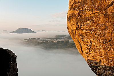 Germany, Saxony, morning mist at Elbe Sandstone Mountains - p300m950024f by Mel Stuart
