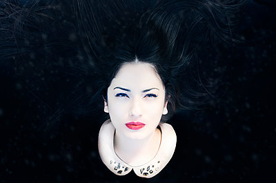 Portrait of a woman with pale face - p1445m1510738 by Eugenia Kyriakopoulou