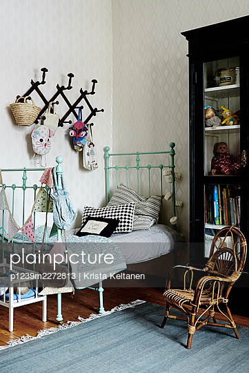 Girl's room with wicker chair - p1239m2272813 by Krista Keltanen