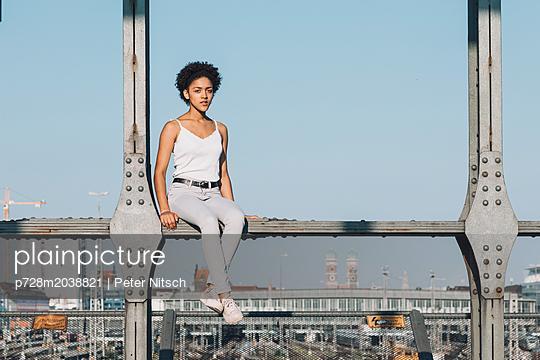 Female teenager on bridge - p728m2038821 by Peter Nitsch
