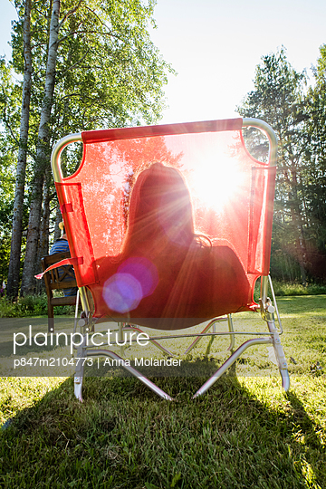 Woman Relaxing On Sun Lounger, Sweden   - p847m2104773 by Anna Molander