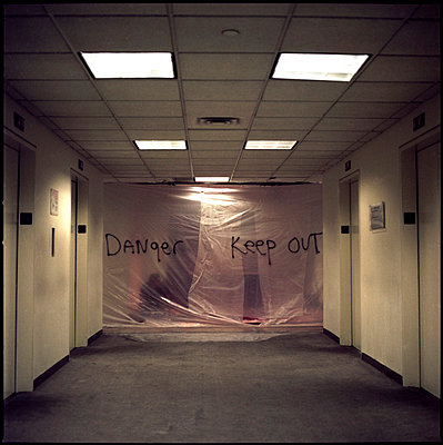 Man behind corridor - p1028m755025 by Jean Marmeisse