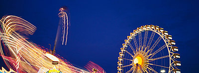 Illuminated fairground rides at night, Oktoberfest, Munich, Germany - p6090598 by WRIGHT