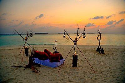 Romantic candle light dinner on the beach - p1183m996161 by Kaktusfactory, Ninprapha Lippert