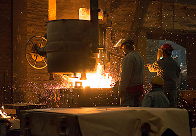 Germany, two men at work in foundry - p300m2213838 by lyzs