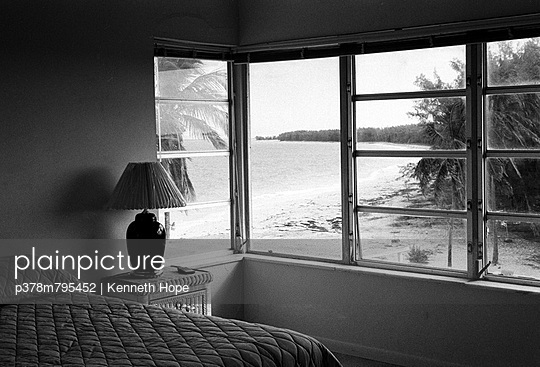 Bedroom with view on beach - p378m795452 by Kenneth Hope