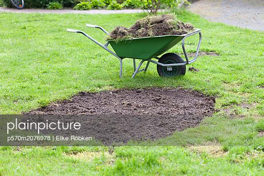 Wheelbarrow with soil - p570m2076978 by Elke Röbken