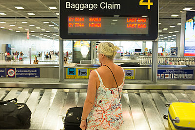 Woman at airport - p312m1211179 by Johan Willner