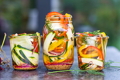Pickeled vegetables and herbs in preserving jar - p300m1189119 by Sandra Roesch
