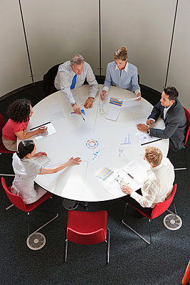 Business colleagues working together in meeting room, high angle view - p92411451 by Igor E.