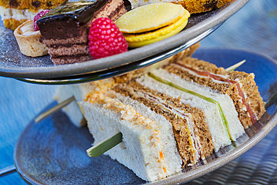 Close up of a selection of sandwiches and cakes, traditional afternoon tea. - p1100m1450820 by Mint Images