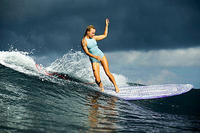 Indonesia, Bali, woman surfing - p300m1206295 by Konstantin Trubavin